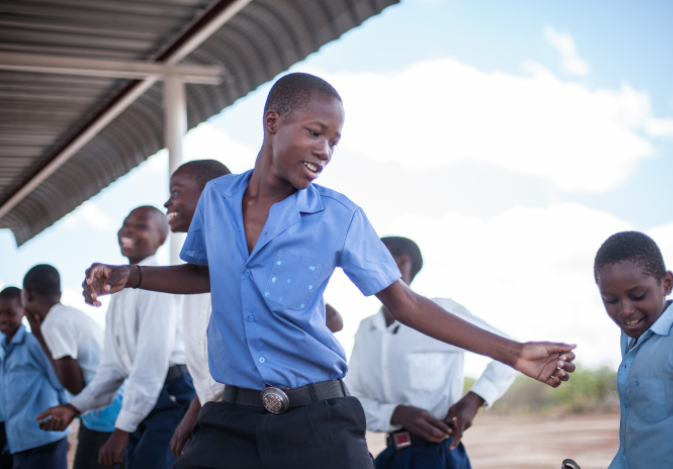Student Dancing with Friends at School